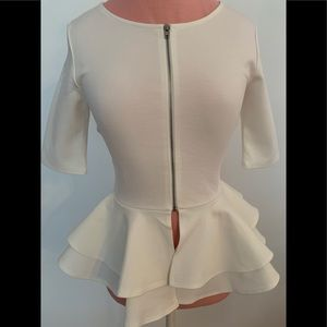 Brand new cream top with peplum and front zipper